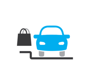 A front-end view of a car with a shopping back floating next to it